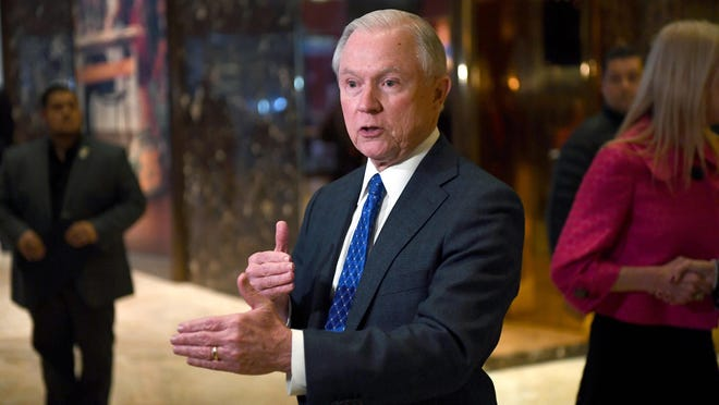 U.S. Senator Jeff Sessions of Alabama talks to the media at Trump Tower in New York after being chosen as Donald Trump's attorney general.