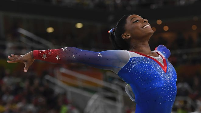 Simone Biles, seen here in a file photo, took to Twitter to defend her body image this week.