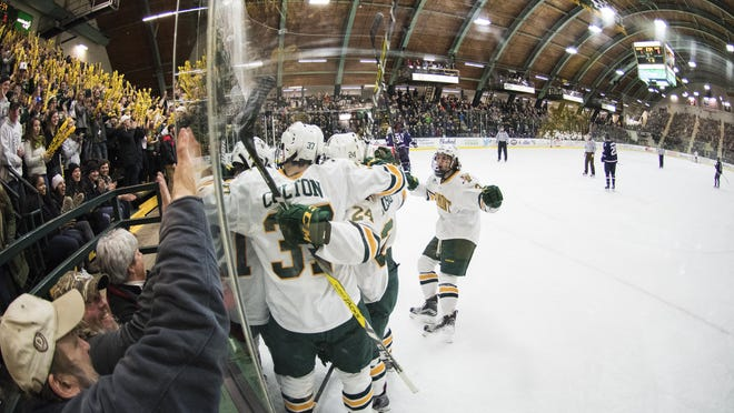 Vermont celebrates a goal during the men's hockey game between the UConn Huskies and the Vermont Catamounts at Gutterson Fieldhouse on Friday night.
