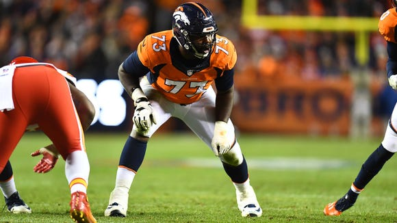 Nov 27, 2016; Denver, CO, USA; Denver Broncos offensive tackle Russell Okung (73) awaits the hike of the football in the first half against the Kansas City Chiefs at Sports Authority Field at Mile High. Mandatory Credit: Ron Chenoy-USA TODAY Sports