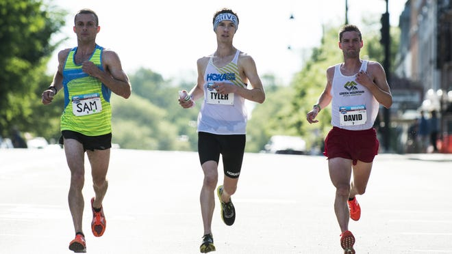 Tyler Andrews (middle), David Sinclair (Right) and Sam Morse make their way down Main Street during the 2017 Vermont City Marathon on Sunday May 28, 2017 in Burlington.