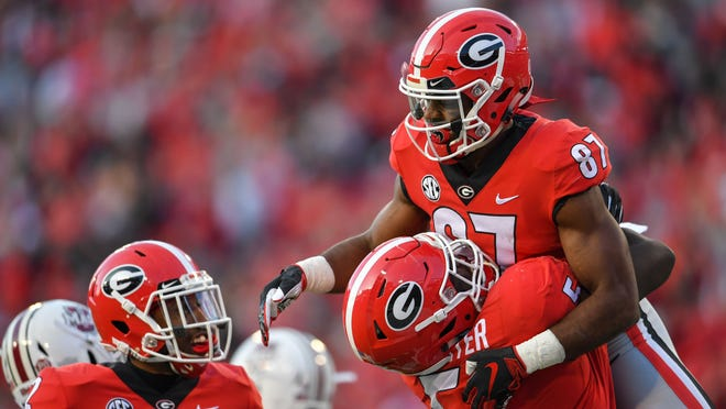 Nov 17, 2018; Athens, GA, USA; Georgia Bulldogs wide receiver Tyler Simmons (87) reacts with defensive lineman Julian Rochester (5) after scoring a touchdown against the Massachusetts Minutemen during the first half at Sanford Stadium. Mandatory Credit: Dale Zanine-USA TODAY Sports ORG XMIT: USATSI-382710 ORIG FILE ID:  20181117_cja_sz2_178.JPG