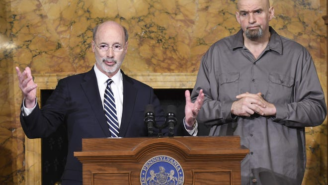 """Gov. Tom Wolf of Pennsylvania speaks at a news conference with Lt. Gov. John Fetterman in his Capitol reception room, Thursday, Jan. 24, 2019 in Harrisburg, Pa. The men announced that Fetterman will open a """"conversation"""" about legalizing marijuana in Pennsylvania by scheduling a series of town hall-style sessions on it. (AP Photo/Marc Levy)"""