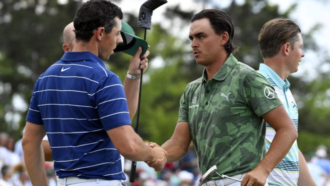 Rickie Fowler (right) and Rory McIlroy, shaking hands hands on the 18th green during the first round of last year's Masters at Augusta National, will be on opposite sides of the  upcoming charity skins game.