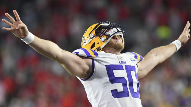 LSU Tigers long snapper Blake Ferguson reacts during the fourth quarter of the game against the Mississippi Rebels.