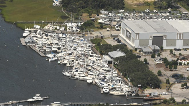 Boats are stacked on top of each other in the Southport Marina Tuesday after Hurricane Isaias came ashore overnight in Brunswick County as a Category 1 hurricane.