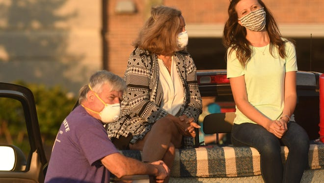 Some concertgoers wore masks Thursday while attending an outdoor concert in downtown Wilmington. Starting Friday afternoon, Gov. Roy Cooper has ordered that masks must be worn in public areas to help stem the spread of COVID-19.