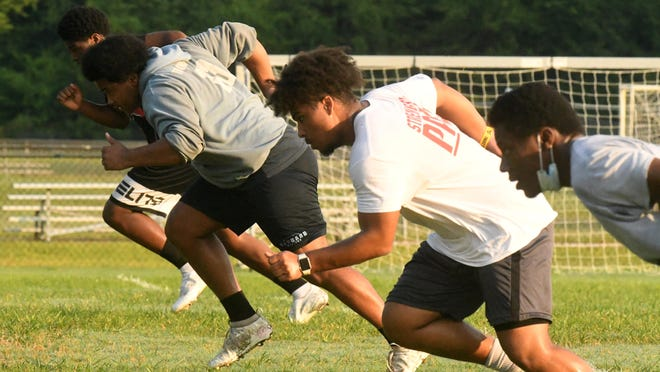 Members of the Hoggard football team practice Monday July 6 at Hoggard High School. Fall sports athletes finally got the chance to be in person with coaches and teammates for the first time as New Hanover County schools began allowing practice sessions.