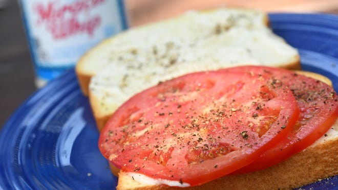 Tomato sandwich with Miracle Whip, fresh ground pepper served on brioche bread.