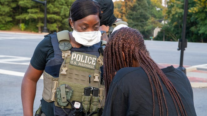A federal marshal at work at an undisclosed location.
