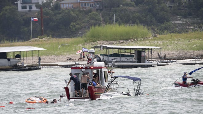 Boats are swamped by waves at the boat parade honoring President Donald Trump on Saturday at Lake Travis.