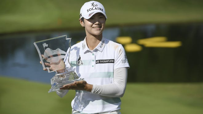 Sung Hyun Park holds up the trophy after winning the LPGA Walmart NW Arkansas Championship golf tournament, Sunday, June 30, 2019, in Rogers.