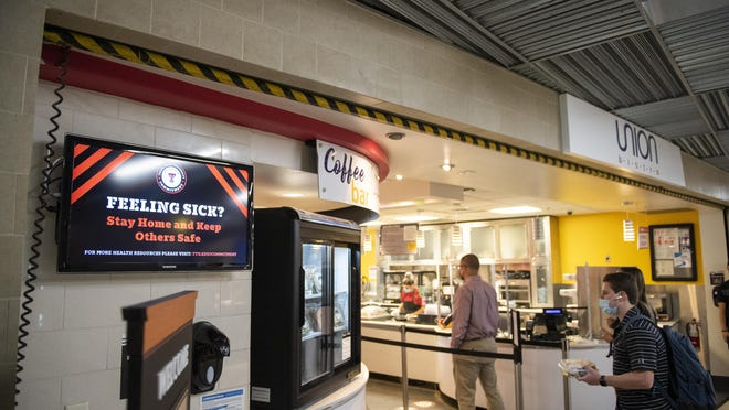 Video boards throughout the Student Union Building show health and social distancing messages to passers by on the Texas Tech University campus on the first day of the Fall 2020 semester on Monday, Aug. 24, 2020, in Lubbock, Texas.
