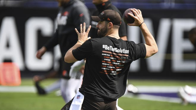 Cleveland Browns quarterback Baker Mayfield (6) warms-up before an NFL football game against the Baltimore Ravens, Sunday, Sept. 13, 2020, in Baltimore.