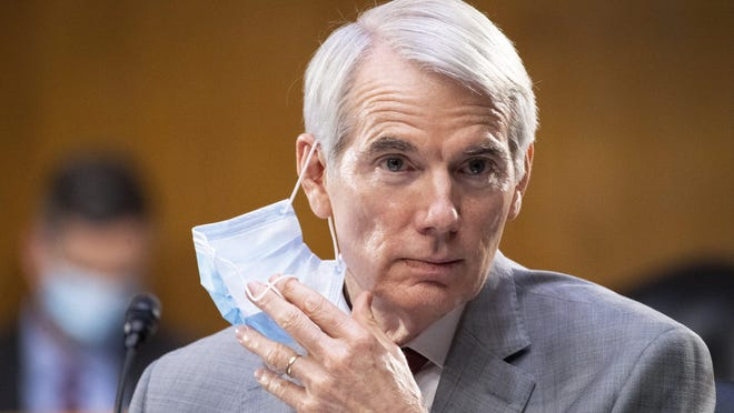 "Sen. Rob Portman, pictured during a committee meeting in June, deflected criticism of President Donald Trump's comments to journalist Bob Woodward as being an ""armchair quarterback."" [Caroline Brehman/CQ Roll Call/Pool via AP)"