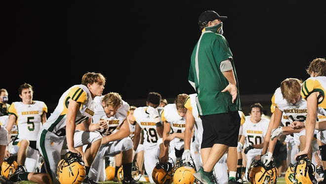 Rock Bridge head football coach Van Vanatta addresses his team Sept. 4 after a win at Smith-Cotton.