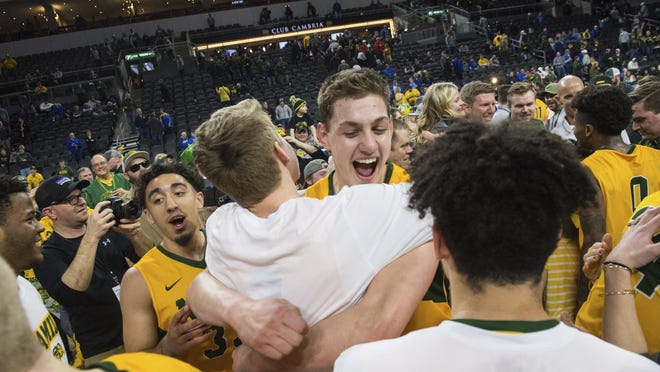 North Dakota State players celebrate after a win over Omaha during an NCAA college basketball game for the Summit League men's tournament championship, Tuesday, March 12, 2019, in Sioux Falls, S.D.