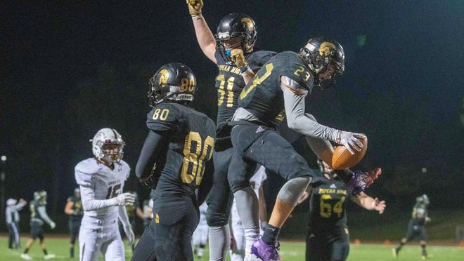 Topeka High's Geivonnii Williams (23) celebrates with his teammates after scoring a touchdown against Garden City last season. Williams is a returning All-City Top 11 selection.
