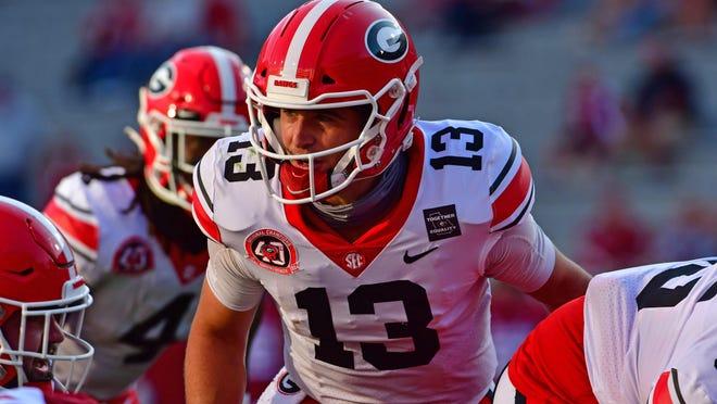 Georgia quarterback Stetson Bennett (13) during the Bulldogs' game with Arkansas in Fayetteville, Ark., on Saturday, Sept. 26, 2020.