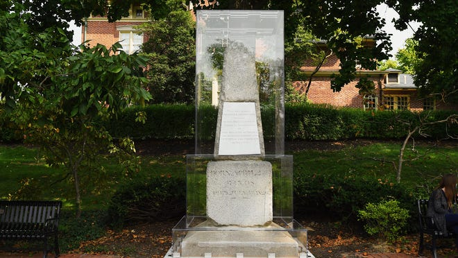 Thomas Jefferson's original tombstone sits on the Francis Quadrangle, located on the University of Missouri campus on Sunday surrounded by a a $20,000 acrylic case.