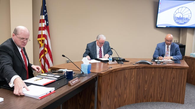 Shawnee County commissioners, from left, Kevin Cook, Bill Riphahn and Aaron Mays conduct business at a regularly scheduled Shawnee County Commission meeting. Commissioners on Thursday were upbraided by a resident for the mask mandate they approved Monday.