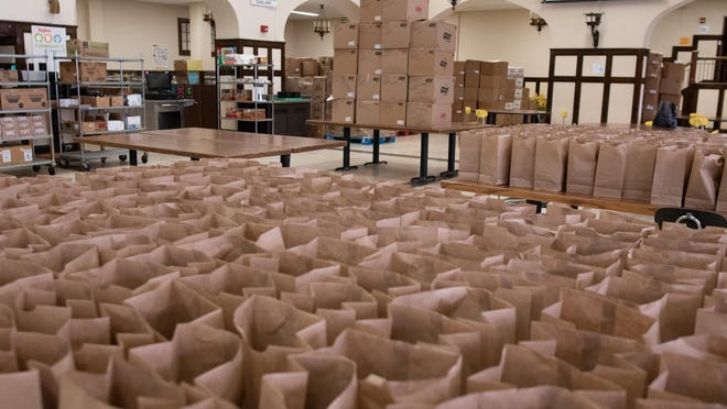 Bags are lined up ready to receive meals at Topeka High School for the USD 501 summer school meal program. With the program ongoing through the end of August, children's nutrition specialist Chris Wagner estimates the program will eventually have served over 400,000 meals.