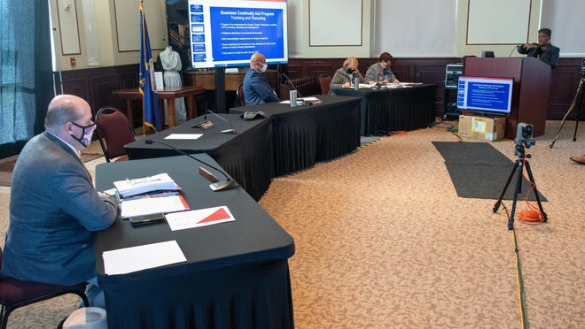 Shawnee County Commissioners heard from Glenda Washington, right, senior vice president of entrepreneurial and minoritybusiness development for the Greater Topeka Partnership, who presented over the creation of the Small Business Continuity program through the GTP Monday morning.