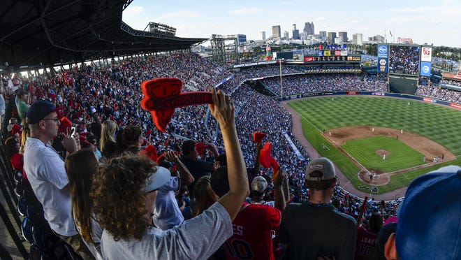 In this Oct. 2, 2016 file photo, Atlanta Braves fans cheer with a tomahawk chop during the ninth inning of a baseball game against the Detroit Tigers, and the Braves' final game at Turner Field in Atlanta.  Braves officials say they have had and plan to continue talks with Native American officials to create 'a stronger bond' between the organization and the group. The Braves did not distribute their traditional red foam tomahawks to fans before Game 5 of their NL Division Series vs. the St. Louis Cardinals Oct. 9, 2019.