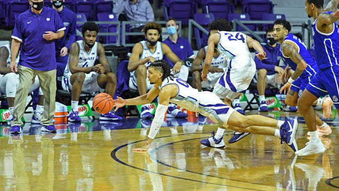Kansas State's Mike McGuirl (00) dives for a loose ball during Wednesday's game against Drake at Bramlage Coliseum in Manhattan.