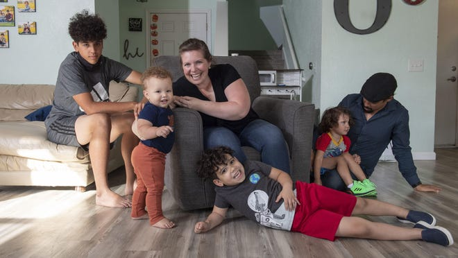 Nicole and Brandon Overton and their family, Greeley, 1, Saben 4, Kafry, 6, and Mayken, 16, had many improvements made to their home, including new baseboards.