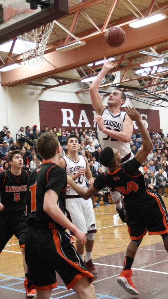 Scarsdale's Will Hoffman (32) goes over Mamaroneck's