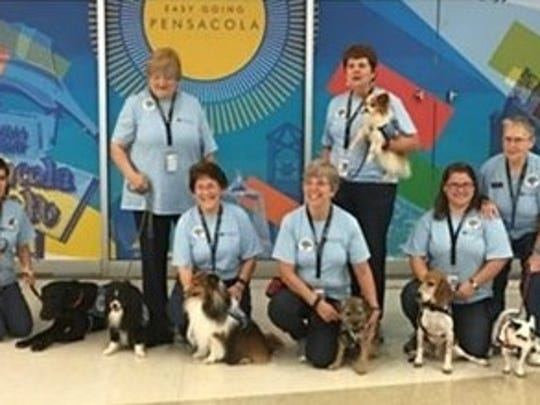 "Pensacola International Airport has partnered with Caring Canines of Five Flags Dog Training Club of Pensacola to establish the ""Pup Patrol,'' which will greet and comfort passengers and visitors from 9:30 a.m. to 11:30 a.m. weekdays."