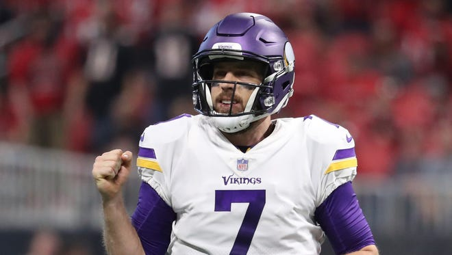 Minnesota Vikings quarterback Case Keenum (7) reacts after a first down in the fourth quarter against the Atlanta Falcons at Mercedes-Benz Stadium.