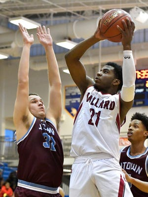 Ballard 's Delonta Wiberly (21) puts up a shot over the defense of Jeffersontown's Chris Trigg (32) during the first half of a LIT basketball game, Monday, Jan. 8, 2018, in Louisville, Ky.