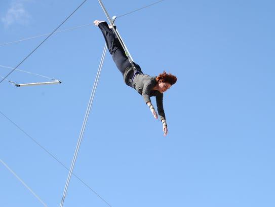 Carolyn Hennesy on a trapeze.