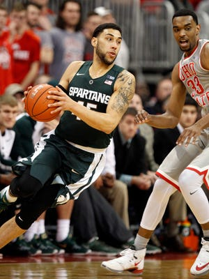 Michigan State's Denzel Valentine, left, works against Ohio State's Keita Bates-Diop during Tuesday night's game in Columbus. Valentine finished with 17 points, eight assists and five rebounds in the Spartans' 81-62 win.
