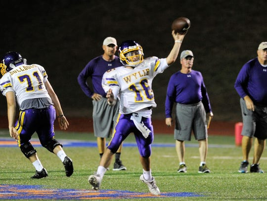 Wylie quarterback Sam King lets a pass go during Thursday's