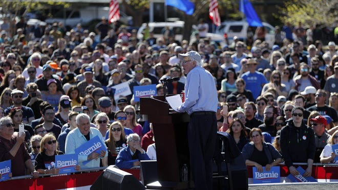In this March 16, 2019, photo, Democratic presidential candidate Sen. Bernie Sanders, I-Vt., speaks at a rally in Henderson, Nev. One of the big questions facing Sanders is whether he could translate his upstart success from 2016 into front-runner status in 2020. So far, the answer is yes.
