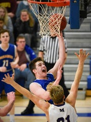 St. Cloud Cathedral's Michael Schaefer takes a shot over Melrose's Jordan Klaphake during the second half Tuesday, Jan. 17 at Cathedral High School.