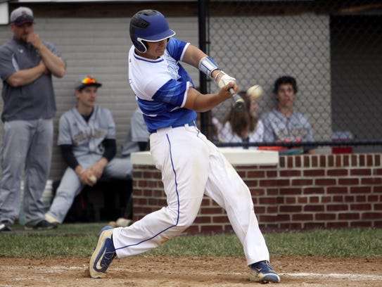 Waynesboro's Brady Riddell crushes a pitch for a home