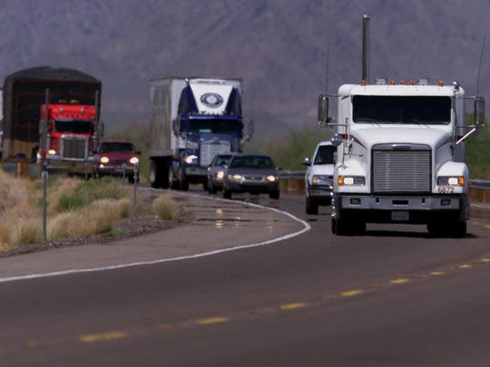 Trucks run State Route 85 near Gila Bend night and