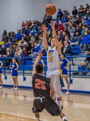 Bloomfield's Damion Sanchez makes a 3-pointer over Gallup's Seth Manuelito on Thursday at Bobcat Gym in Bloomfield.