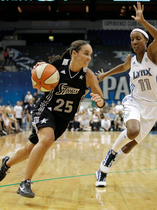 "File- This Aug. 4, 2011 file photo shows San Antonio Silver Stars guard Becky Hammon, left, driving past Minnesota Lynx guard Candice Wiggins in the first half of a WNBA basketball game in Minneapolis. Hammon's return from injury is critical to the team's fortunes. Entering her 16th season, she has career averages of 13.3 points and 3.8 assists. ""Becky makes things work,"" coach Dan Hughes said. ""She's veteran enough to understand not only her position, but the totality of what we're doing. She can communicate it on the floor in a way that provides understanding and that's what your great players do."" (AP Photo/Stacy Bengs, File)"