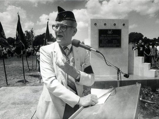 Dr. Hector P. Garcia speaks in front of the Molina Vietnam Veterans Memorial in May 1987.