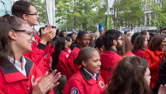 The 71 new City Year Detroit corp members celebrate during the Opening Day ceremony on Friday, September 8, 2017 in Campus Martius in Detroit.