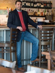 Michael Dickinson of Lewes wears a Ralph Lauren blazer and button-down shirt, a J. Crew crew-neck sweater and Hudson Byron straight-leg slim-fit jeans.