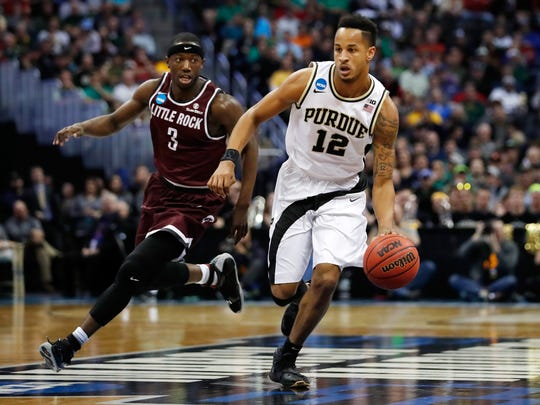 DENVER, CO - MARCH 17:  Vince Edwards #12 of the Purdue Boilermakers drives the ball past Josh Hagins #3 of the Arkansas Little Rock Trojans during the first round of the 2016 NCAA Men's Basketball Tournament at the Pepsi Center on March 17, 2016 in Denver, Colorado.  (Photo by Justin Edmonds/Getty Images)