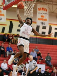 Aspire Academy's Caleb Fields (0) flies in for a dunk