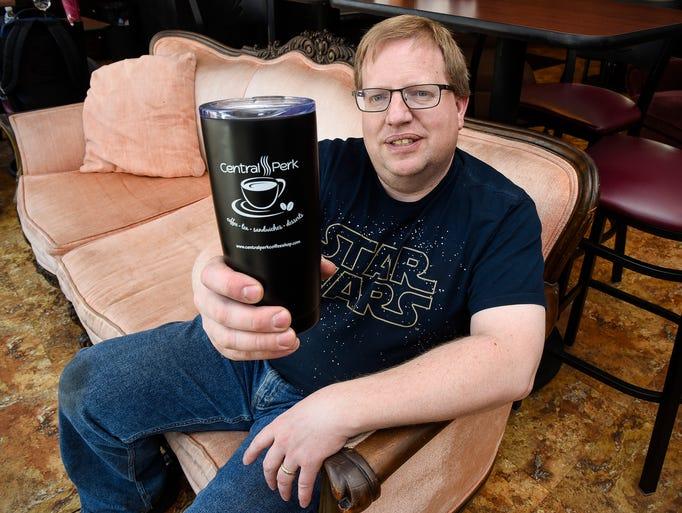 Alan Scherr, owner of Central Perk Coffee Shop, is