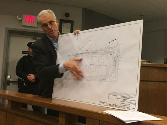 Belleville Township Engineer Thomas Herits presents plans for a track at the local high school to members of the public on Tuesday, Jan. 24, 2017.